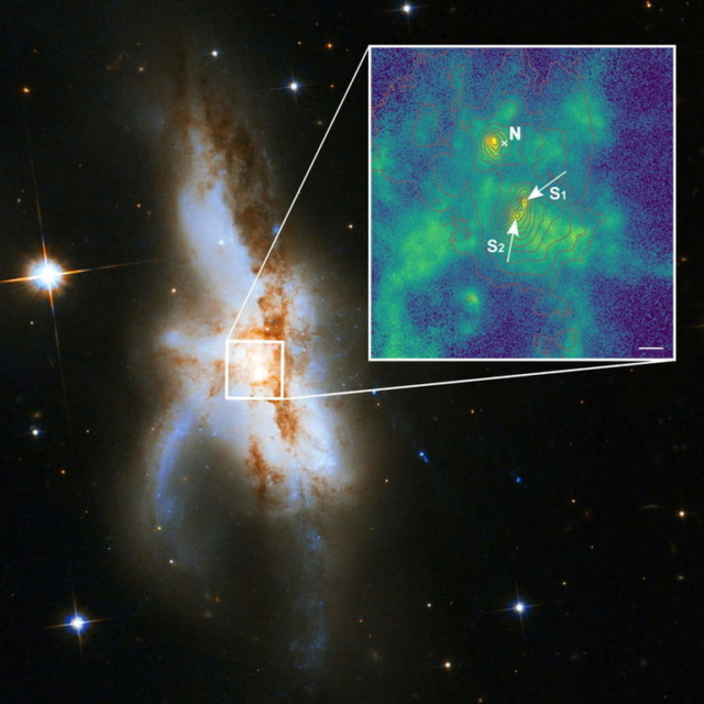 astronomers galaxy three supermassive black holes